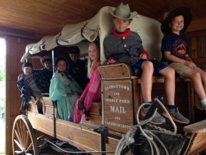 kids in stage coach